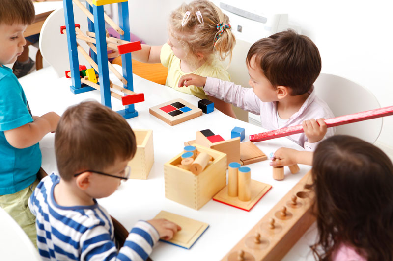 group of toddlers playing with educational toys