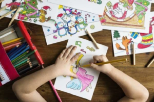 child colouring on christmas drawings