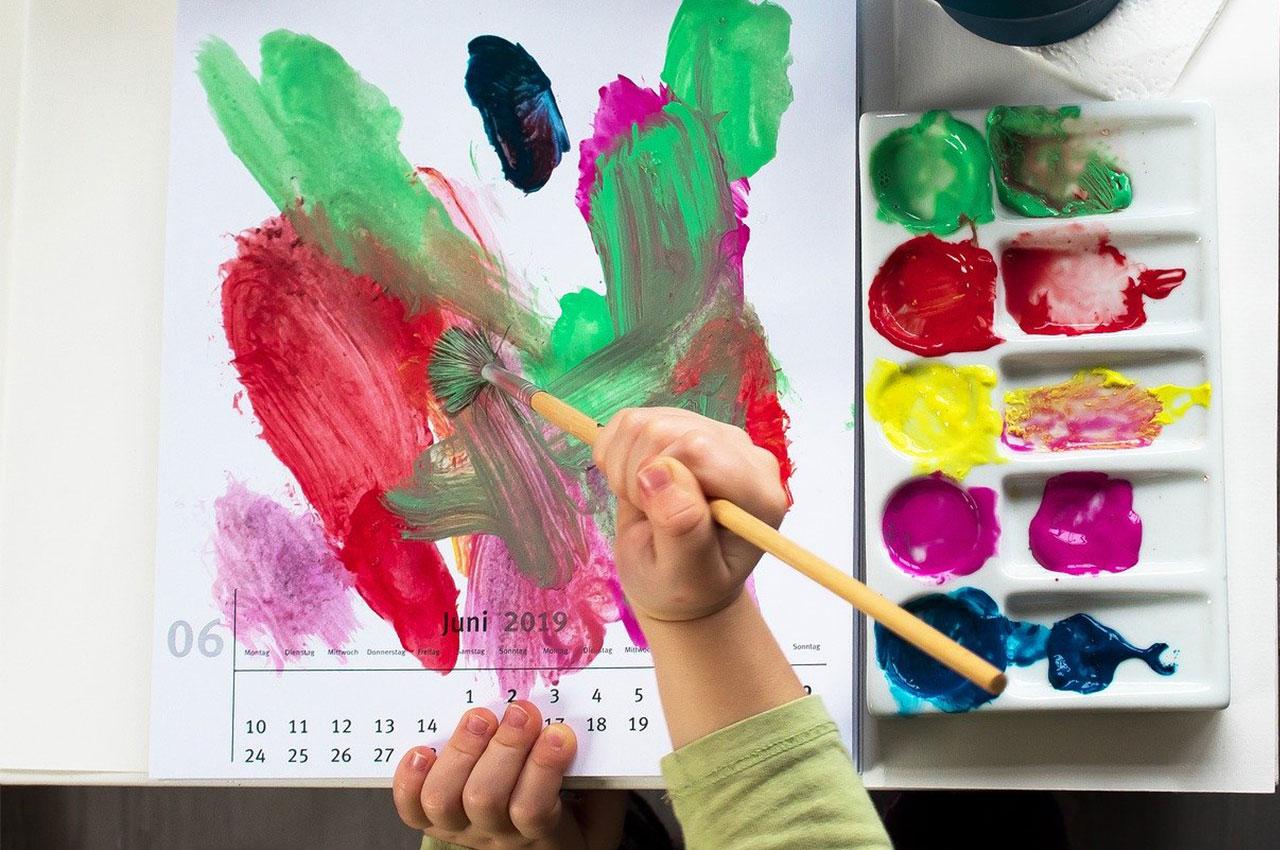 kid painting on calendar