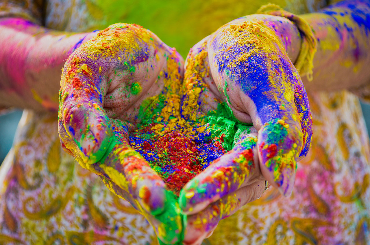 hands full of coloured powder