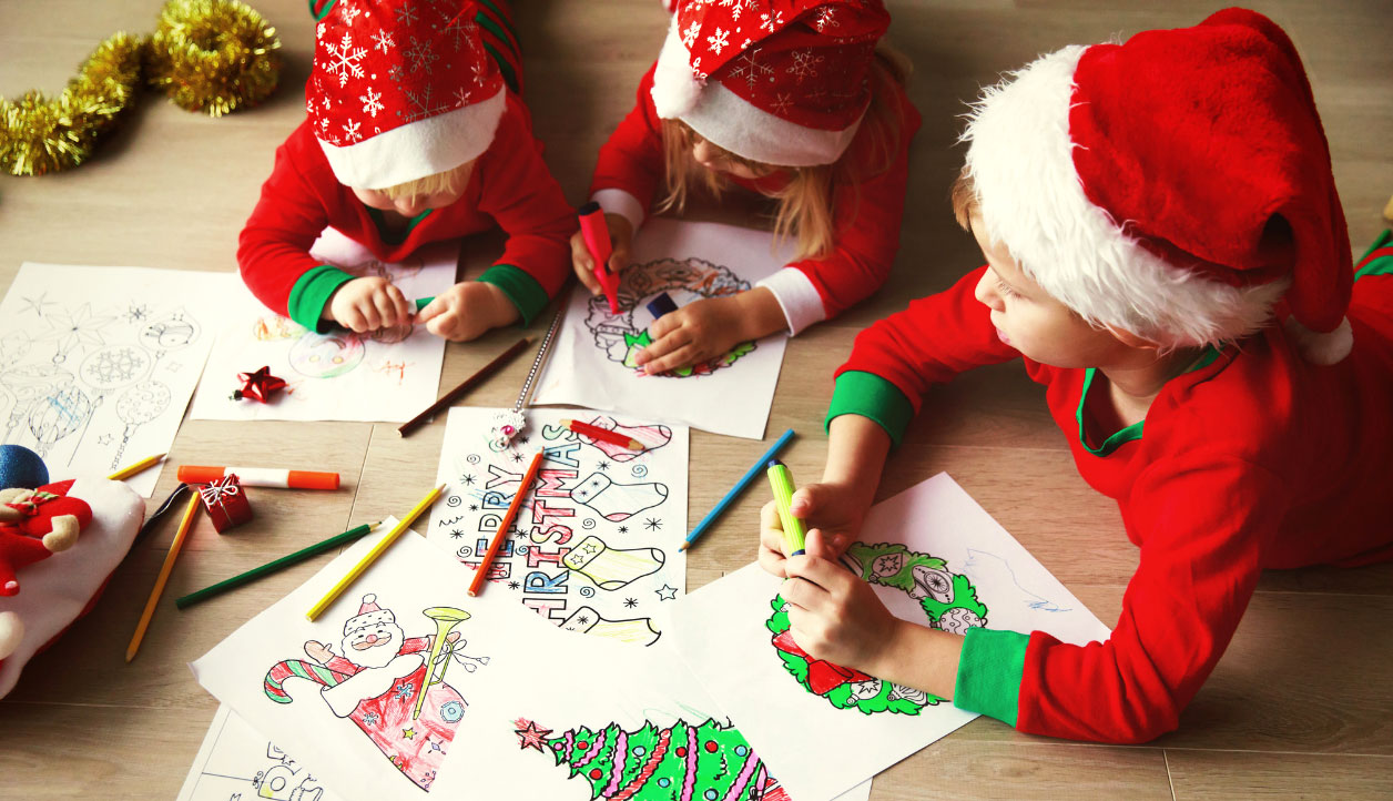 kids in santa hats making Christmas art