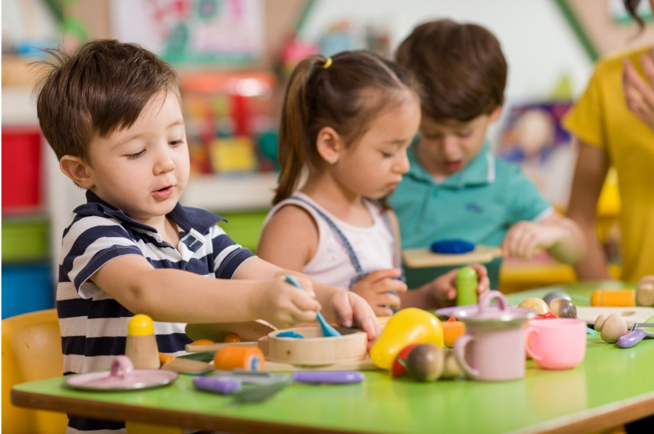 preschool children playing in classroom