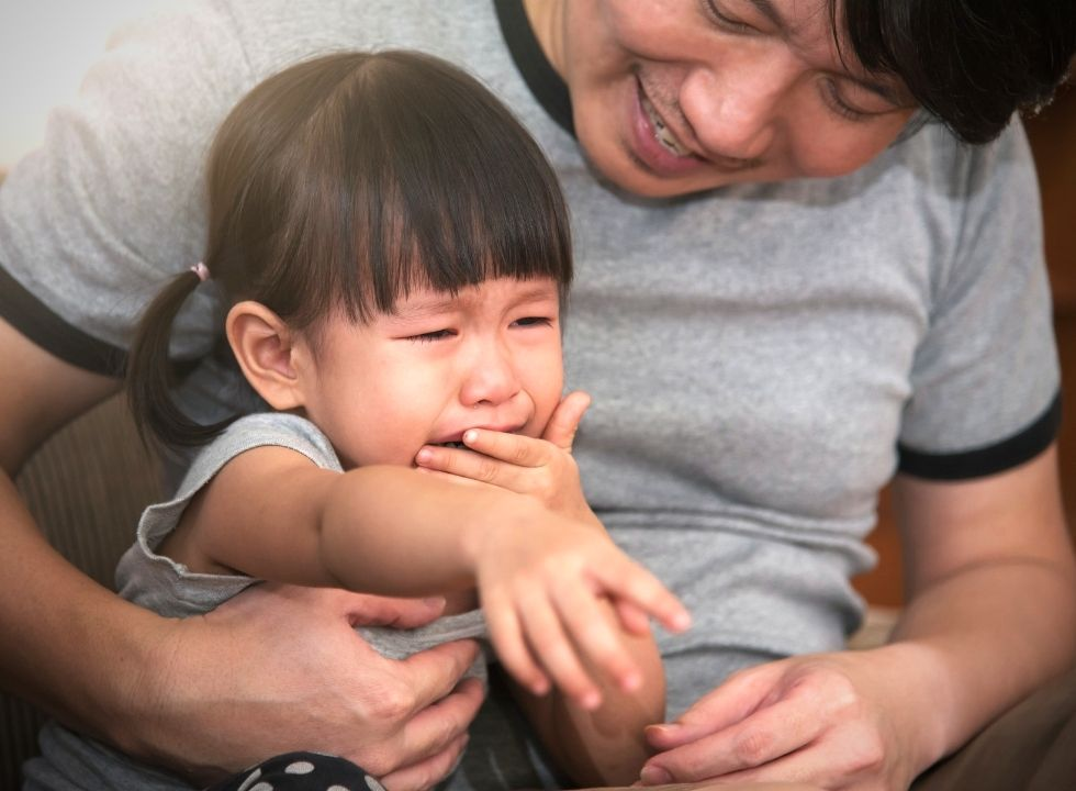 managing tantrums and consoling a crying child