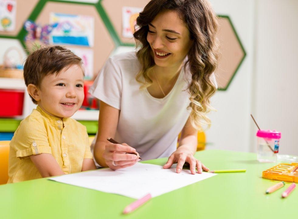 Teacher and child in classrooom